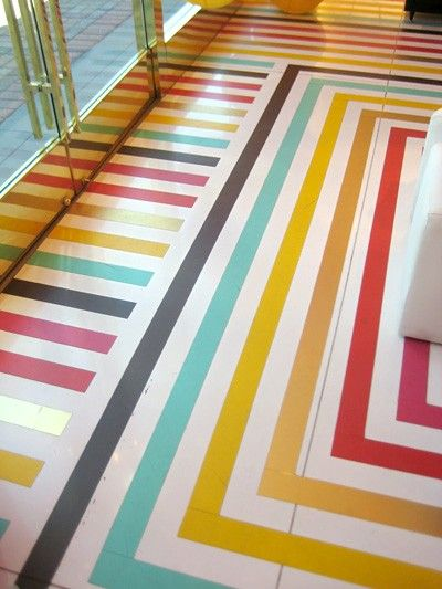 """Placing vinyl tape on your floors is  easier than painting stripes and according to Tim Nye, who has the most awesome vinyl striped floor, it is practical.  """"Anytime it gets ripped or scuffed, I just cut out the ruined piece and replace it with fresh tape in the same color."""""""