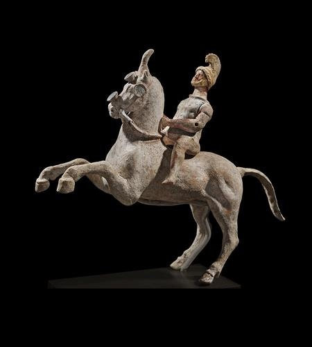 This figure represents a Greek terracotta horse and rider from the Canosan Hellenistic Period, which can be considered the period from the death of Alexander the great (323 B.C.) to the battle of Actuim (31 B.C.) This very fine horse and rider was molded of tan clay and then lavishly painted with the vibrant polychrome that is typical of Hellenistic terracotta's from Magna Græcia. From CENTURIPE , Sicily Italy - NYC private collection