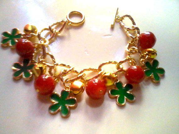 Flower charm bracelet with gold tone bells by KaterinakiJewelry