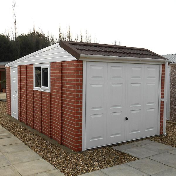 Wonderful LidgetCompton Pent Mansard Garage. With A Flat Roof And Tile Effect Front  Elevation,