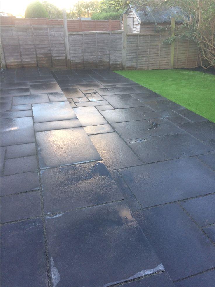 A Beautiful black stone patio design for your garden.