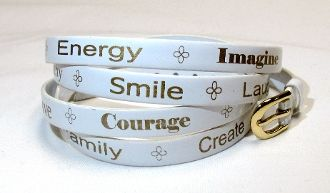 "Proudly wear the Smartte Positive Word Wrap Bracelet and get motivated all day long!  Feel inspired as this trendy bracelet displays positive words including: Happy, Energy, Imagine, Confidence, Healthy, Laugh, Smile, Achieve, Love, Courage, Fun, Values, Family, Create, Beautiful and more!  This Smartte Positive Word Wrap Bracelet is approximately 36"" long and is made from animal friendly synthetic leather.."