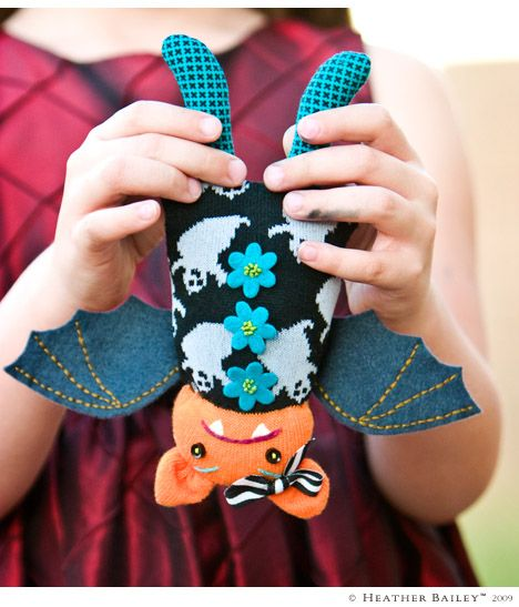 """For Boo and Ky - Betty Boo Bat sock doll ~ Materials: 1 Sock with contrast toe & heel, Fabric scrap for legs, wool-blend Felt for wings, 1/4 yd. of 1/4""""-3/8"""" wide Ribbon, 2 small (1/4"""") Buttons for eyes, Felt for shirt flowers or Buttons, Embroidery Floss for eyebrows, mouth & optional flowers, Polyester stuffing, Thread. Download pattern."""