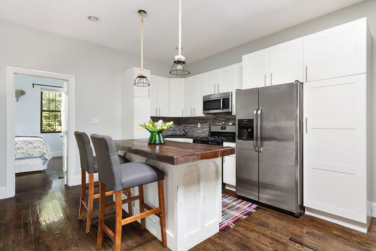 This renovated townhouse in Bedford-Stuyvesant comes with a backyard and a rental unit