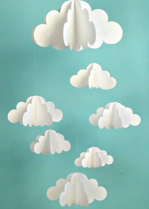 Paper clouds above desks~   Nik this would be a cute baby shower gift with quilt or diaper cake: