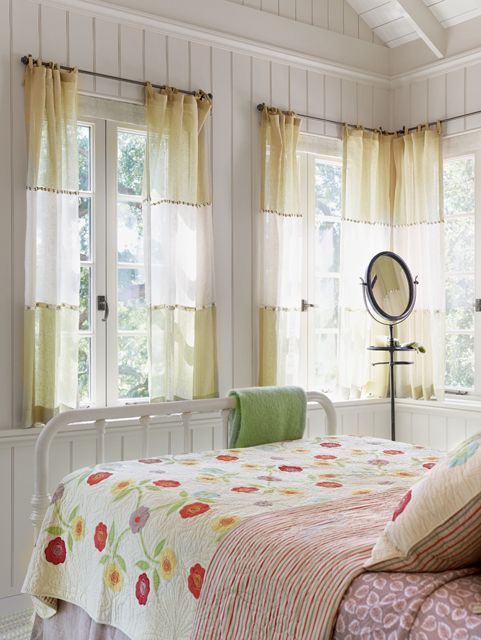 Bedroom - bright with airy curtains and a cheery quilt.