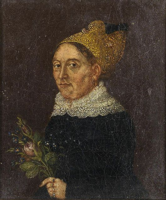 Unknown artist - Portrait of a Woman with a Goldhaube and a Flower. The shape of the traditional hat, the goldhaube, was most commonly a padded silk cap, with a wired and starched frill or crest coming out of the back.