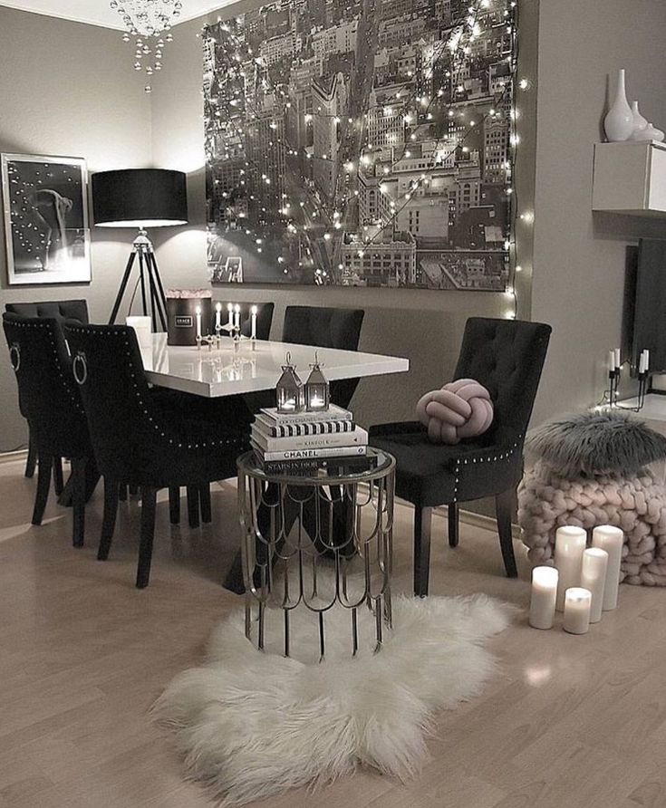 Great home decor idea. Black and white photo of city with white lights strung around to appear like the lights of the city. Brilliant!