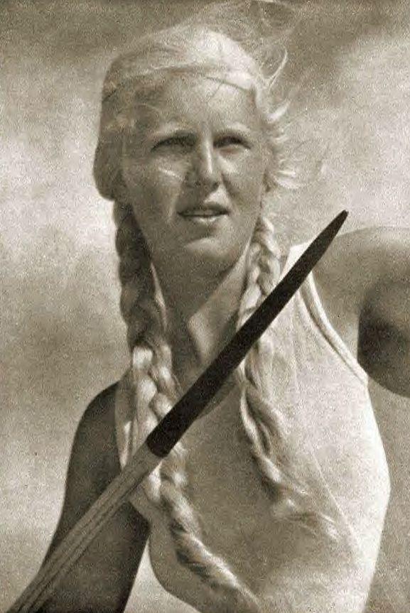 Aryan Spear Woman  Nazi German Athlete Actress from a Leni Riefenstahl film.  Stylish cinematography and light works, Riefenstahl Style!  German  Style Propaganda!