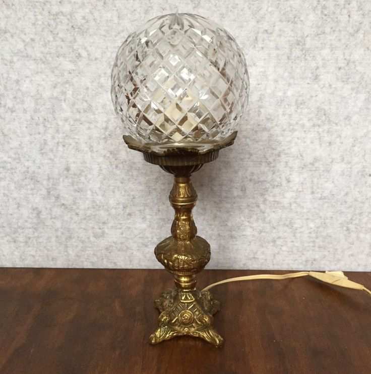 VINTAGE ART DECO BRASS LAMP WITH CRYSTAL SHADE - $95  This Art Deco style table lamp features a cut crystal spherical shade and ornate winged brass base.  Great for adding a touch of unexpected whimsy to your space!