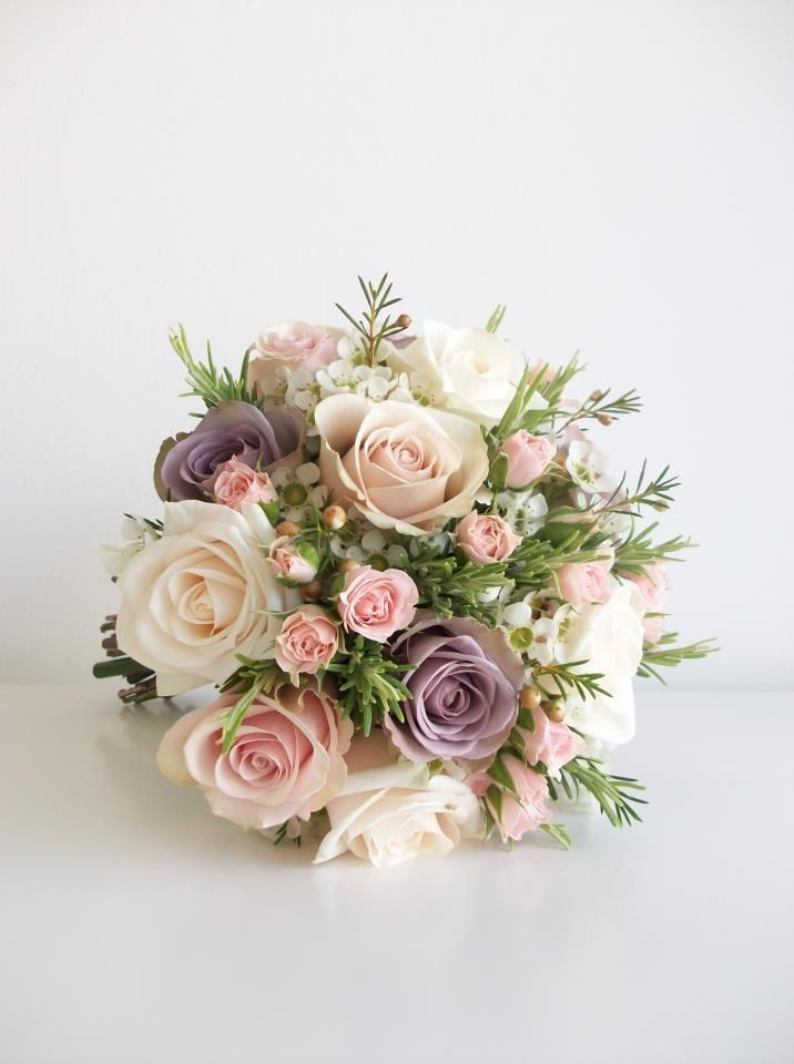 Very elegant bouquet of pastels including rosemary which creates a great texture