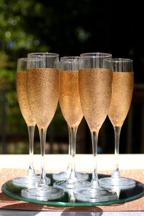 buy a dozen cheap champagne glasses and some of that sparkling fruit juice to mix with sprite or soda water (just use the fancy bottle to pour out of)