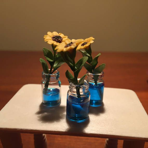 miniature sunflowers in water