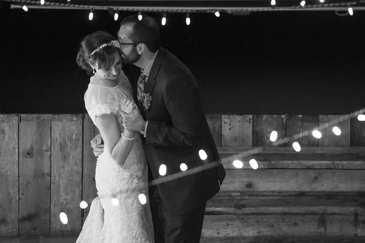 Fairy lights around the dance floor help create stunning first dance photos. This one is at Cornerstone Theatre in Canmore, Alberta. Photo by one-edition.ca.