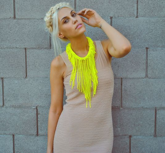 OMG this neck piece.  Need it.  Love it with the nude dress.
