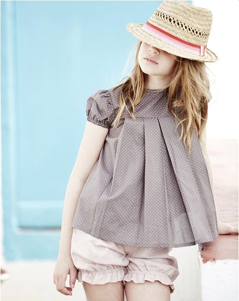 Such a sweet top - love the bloomers and fedora. The height of European fashion cool.