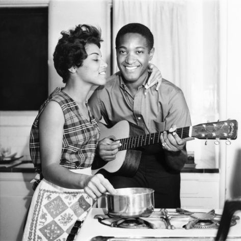 Sam Cooke and wife Barbara cooking and playing music in the kitchen of their home, uncredited