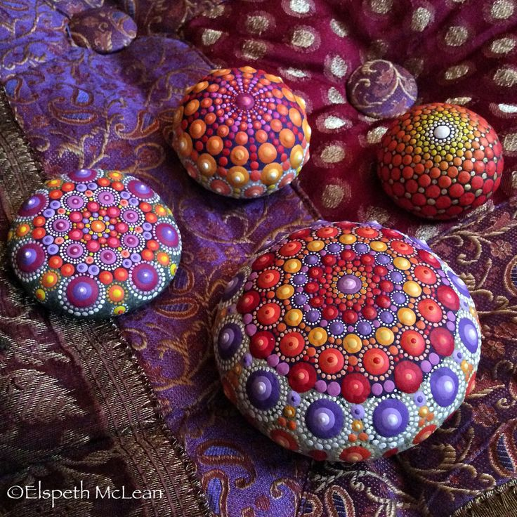 Mandala stone by Elspeth McLean being all chameleon with their surroundings