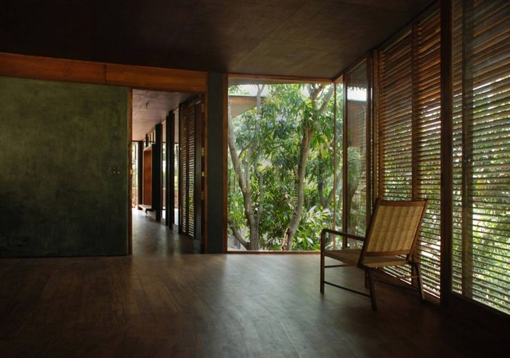 2.5 m floor to ceiling height, with exposed concrete finish and wooden beam resting on wall as part of the design. NICE    Belavali House / Studio Mumbai
