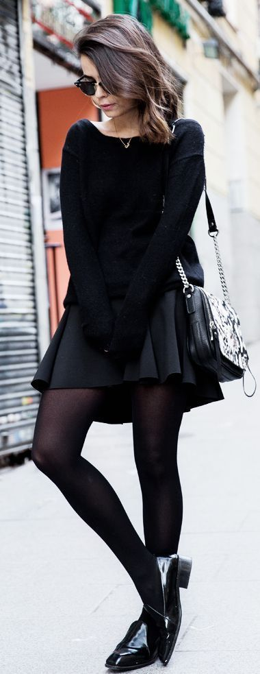 Something as simple as opting for a black oversized sweater and a black skater skirt can potentially set you apart from the crowd. Dress up this look with black leather loafers.   Shop this look on Lookastic: https://lookastic.com/women/looks/oversized-sweater-skater-skirt-loafers/18171   — Black Sunglasses  — Black Oversized Sweater  — Black Snake Leather Crossbody Bag  — Black Skater Skirt  — Black Tights  — Black Leather Loafers