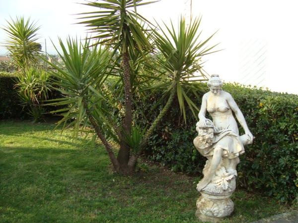 Garden around Villa Baiera in Frascati country; every apartment has a private area with table and chairs for relax in the garden.