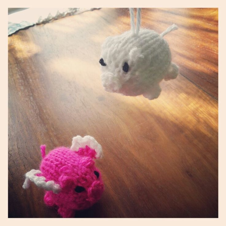 Crocheted winged flying pigs