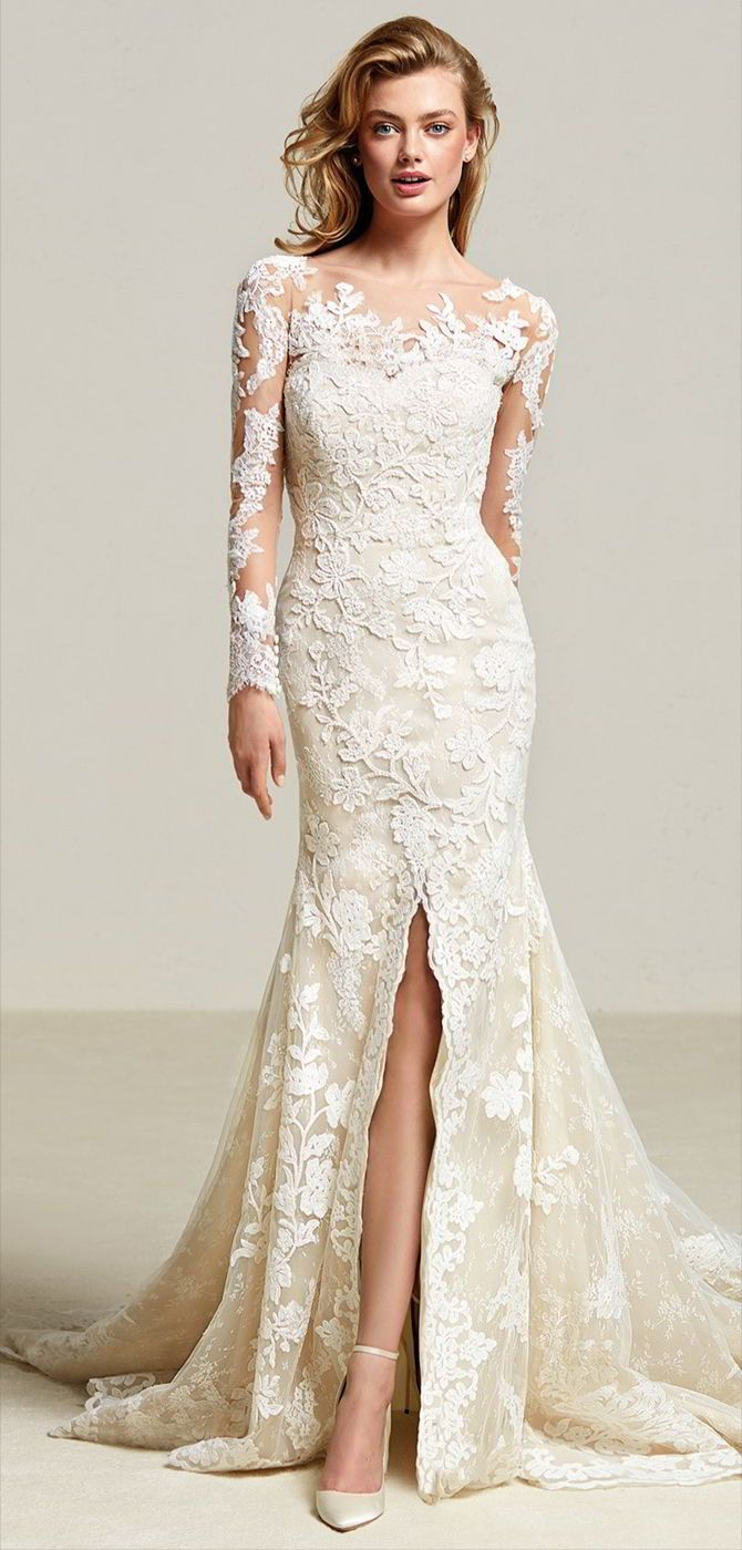 Pronovias 2018 lace mermaid wedding dress - Romance takes over with this lace mermaid design. A very feminine dress with central split in the full skirt with a train. A very sensual dress that blends the semi-sweetheart neckline in Georgette, with a beautiful illusion effect on its long sleeves and back, crafted in crystal tulle with lace, thread embroidery and gemstone appliqués. A design filled with subtleties.