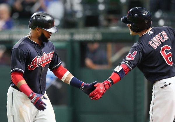 Cleveland Indians Carlos Santana gets congrats from Brandon Guyer after Santana hit a home run in the 8th inning, his second homer in the game against the Cincinnati Reds at Progressive Field, Cleveland, Ohio, on July 24. 2017. (Chuck Crow/The Plain Dealer). Indians won 6-2