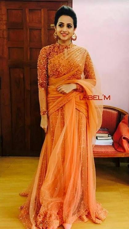 Bhavna in orange saree paired with beaded pearl work