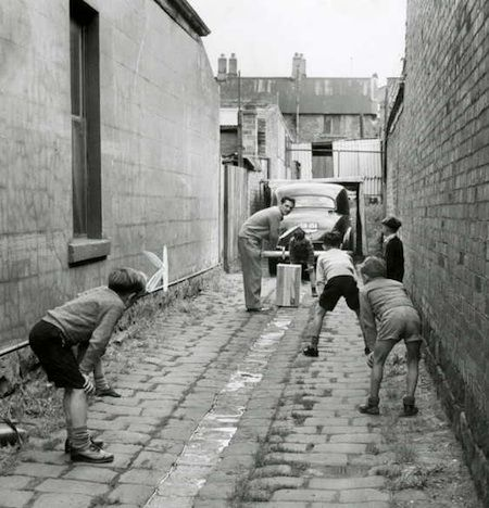 Such a Beautiful Photo! This 1948 photo is cool. It shows the then Australian Cricket team's new batsman Neil Harvey playing cricket with some boys in the laneway next to his family home.
