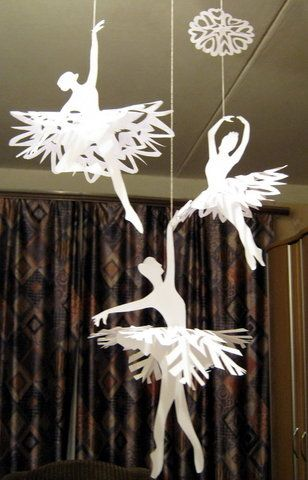DIY Ballerinas' Snowflakes. Snowflakes and cut out silhouettes of ballet dancers. Really