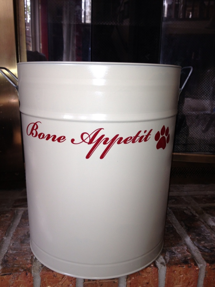 Old popcorn tin converted to a dog food container. Dog
