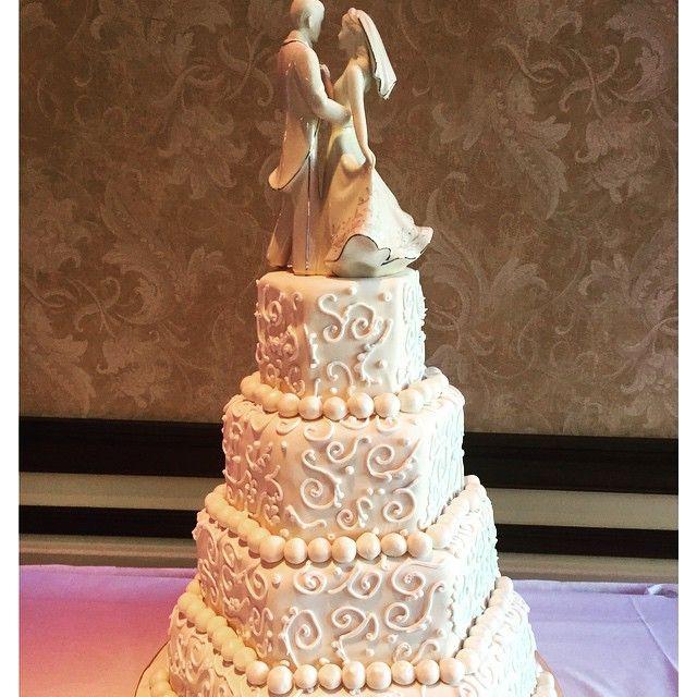 Ivory hexagon wedding cake. #ivory #hexagon #cake #wedding #weddingcake #quidnessettcountryclub #quidnessett #engaged #caketopper #cakeart #cakeporn #cakelove #chefsoninstagram #love #lovecake #lovewhatido #edibleart #art #chefsoninstagram #cakeporn #fondant #lace #beauty #bakerinjohnston #bakerylife #johnstonri #rhodeisland