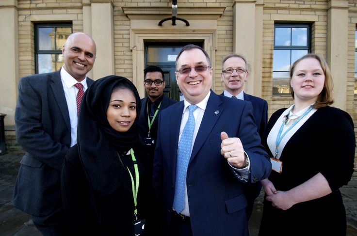 Roger Marsh OBE, paid a visit to Shipley College last week to meet with staff and students and to take a look at the Shipley College Mill Building which has recently undergone a £388,000 refurbishment. Left to right - Principal Nav Chohan, Roger Marsh, OBE and Councillor David Green with our students.