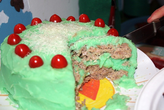 Meatloaf cake with mashed potatoes decorated with little tomatoes and ...