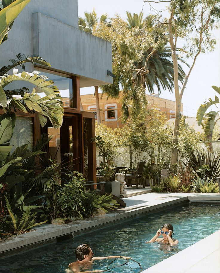 The pool is the only non-solar-powered portion of their home in Venice, California, created by their father, architect David Hertz.