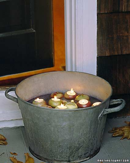 Something about putting candles in buckets makes a yard so country chic and homey...looooove it!