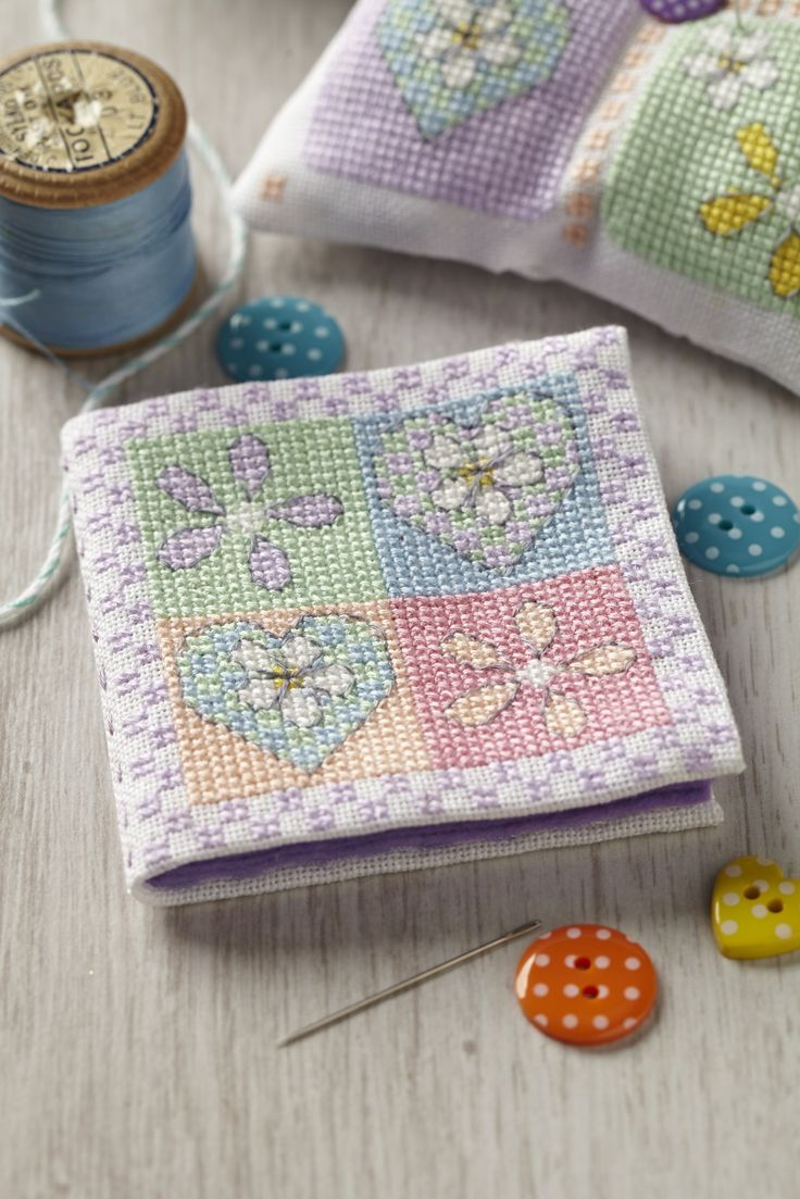 The colours in Diane Machin's needle booklet are so feminine! Get the chart and instruction on how to make it from CSC issue 232 http://www.myfavouritemagazines.co.uk/stitch-craft/cross-stitch-collection-magazine-back-issues/cross-stitch-collection-february-14-issue-232/