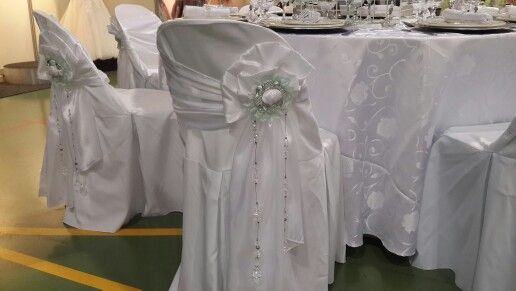 Beautiful and elegant white chairstrips made into flowers with crystal sashes and flower buckles. Only at ACH