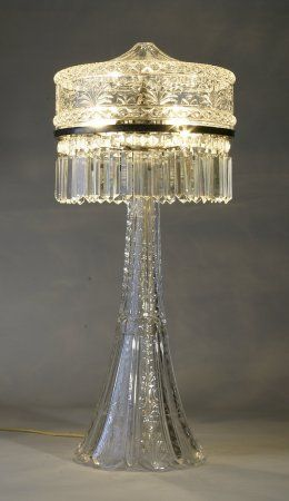 antique Tiffany lamps, Art Nouveau lamps and chandeliers, antique stained and beveled glass from theantiquetraders.com