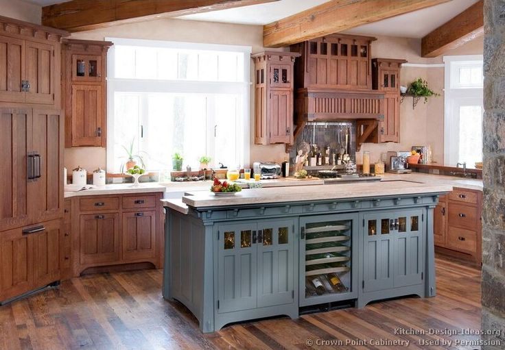 Love the wood of cabinets with the floor. Don't want so much ornamentation on tops of cabinets, and want them floor to ceiling. Like variegated pattern on floor- won't show dirt and flaws. Also the contrast finish on the island (painted versus stained)