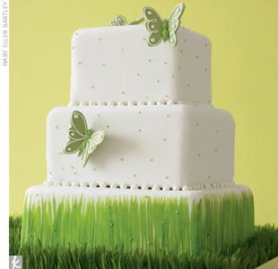 Green wedding cake with a spring theme.