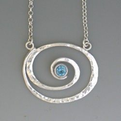 Spiral Sterling Necklace with Blue Topaz. It would look nice with stamped lettering around the spiral as well.