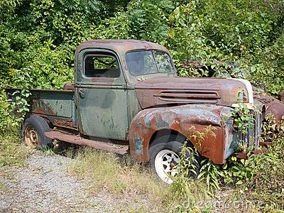Old rusty Ford pickup truck.