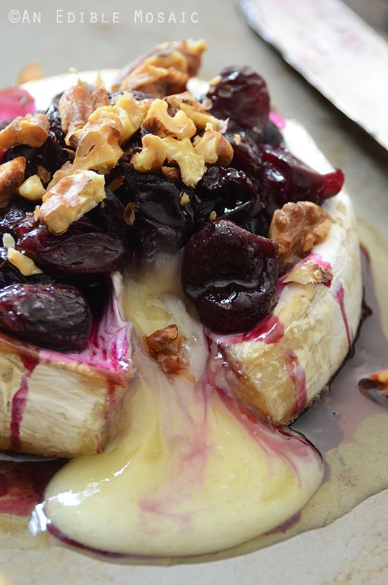 Baked Brie with Warm Honeyed Grapes and Walnuts. The easiest and greatest appetizer to bring to a holiday party!