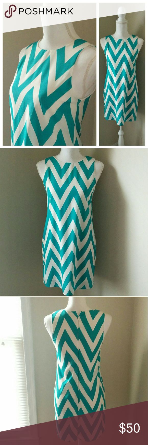 Everly Turquoise Chevron Sleeveless Shift Dress Everly turquoise and white chevron print shift style dress with a back zipper in a size small. The fabric has a slight metallic sheen to it, very cute. Everly Dresses Mini
