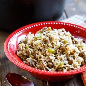 """Dirty Rice is a spicy and flavorful Cajun rice dish made from white rice. It gets its """"dirty"""" color from finely chopped chicken livers and ground beef or pork. The chicken livers give it such a deep flavor. Even if you think you don't like chicken livers, you should try adding them. Since they …"""