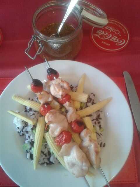 Chicken and tomatoe skewers with Thai fragrant and black rice, babycorn, spring onion and homemade sweet chilli sauce