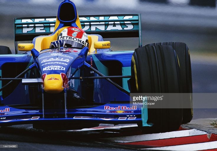 Johnny Herbert of Great Britain drives the #15 Red Bull Sauber Petronas Sauber C17 Petronas V10 during the Hungarian Grand Prix on 16th August 1998 at the Hungaroring Circuit, Budapest, Hungary.