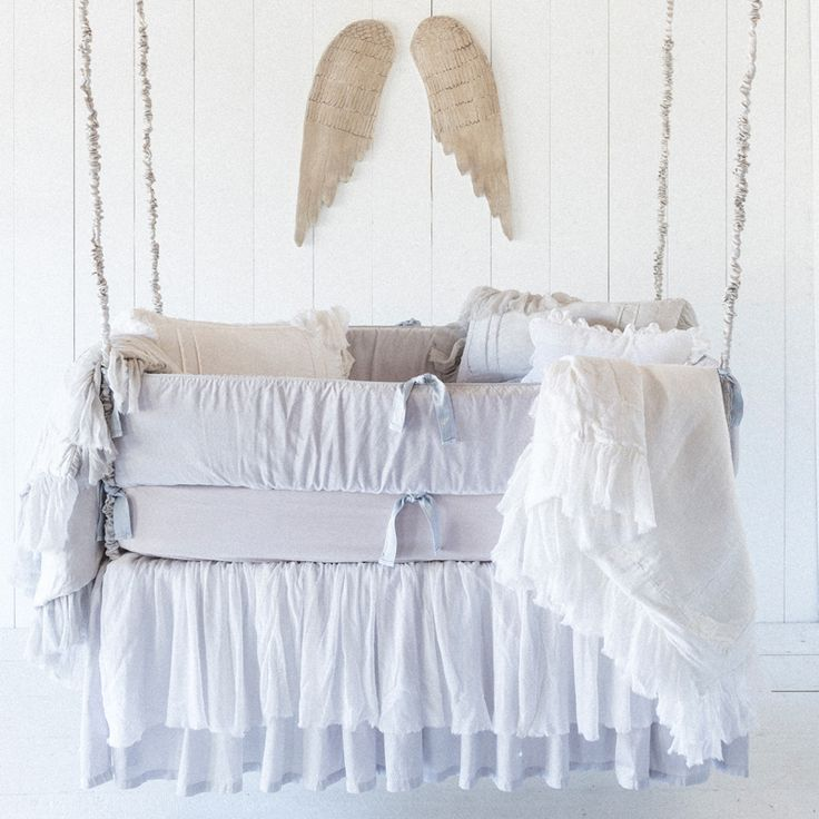 Love the angel wings above this heavenly crib bedding